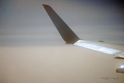 Photograph - Wingtip Light by Paulette B Wright