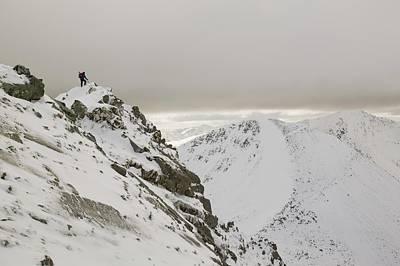 Winter Climber Ascends An Garbhanach Print by Ashley Cooper