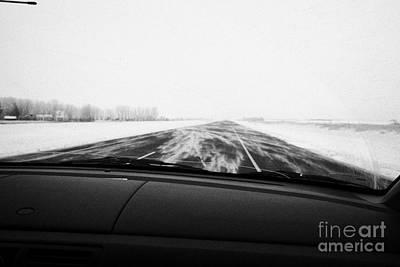 winter driving along Saskatchewan highway 11 from Saskatoon to Regina with cracked windscreen and wi Art Print