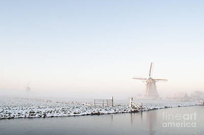 Photograph - Winter Windmill Landscape In Holland by IPics Photography