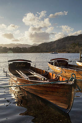 Woden Boats Tied At The Water S Edge Art Print