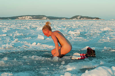 Naked Photograph - Woman Bathing Naked In Ice Hole by Helena Wahlman