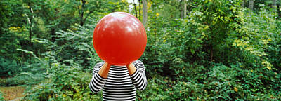 Obscured Faces Photograph - Woman Blowing A Balloon, Germany by Panoramic Images