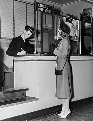 Western Purses Photograph - Woman Buying A Plane Ticket by Underwood Archives