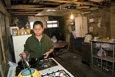 Sonora Photograph - Woman Cooking In A Slum by Jim West