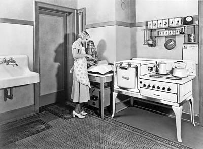 Oven Photograph - Woman Cutting A Homemade Cake by Underwood Archives
