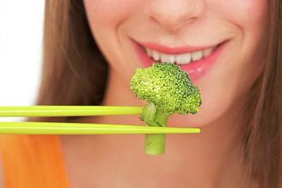 Broccoli Wall Art - Photograph - Woman Eating Broccoli by Lea Paterson/science Photo Library