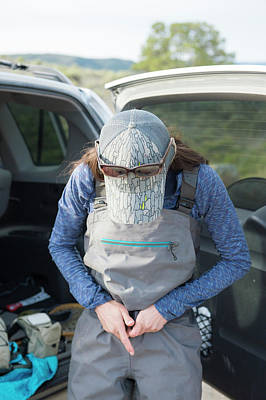 Colorado Fly Fishing River Wall Art - Photograph - Woman Fastening Belt Beside Car by Jennifer Magnuson