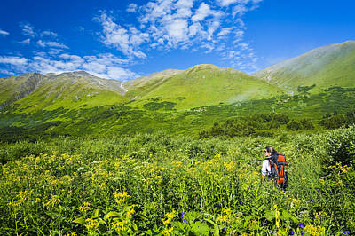 Carter Lake Photograph - Woman Hiking On The Carter Lake Trail by Michael DeYoung