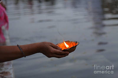 Puja Photograph - Woman Holding A Candle Beside The River Ganges In Rishikesh India by Robert Preston