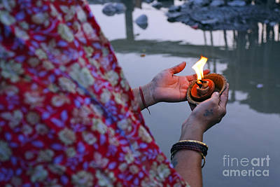 Puja Photograph - Woman Holding A Candle By The River Ganges In Rishikesh India by Robert Preston