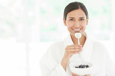 Bathrobe Photograph - Woman Holding Bowl Of Fruit And Spoon by Ian Hooton