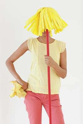 Obscured Face Photograph - Woman Holding Mop In Front Of Face by Ian Hooton