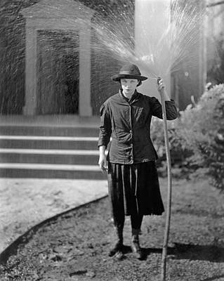 Pissing Photograph - Woman Hoses Herself by Underwood Archives