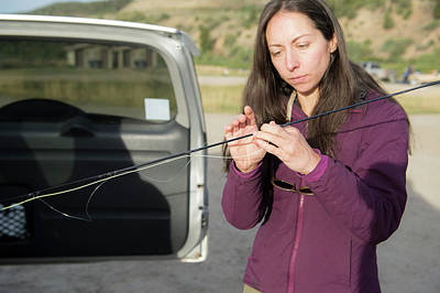 Colorado Fly Fishing River Wall Art - Photograph - Woman Inspecting Fishing Rod, Colorado by Jennifer Magnuson