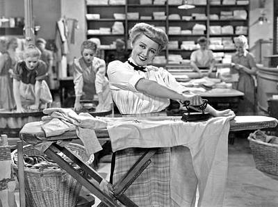 Vintage Laundry Photograph - Woman Ironing In Laundry by Underwood Archives