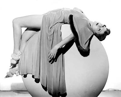 Woman Lying On Exercise Ball Art Print by Underwood Archives