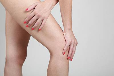 Woman Massages Her Painful Knee Art Print