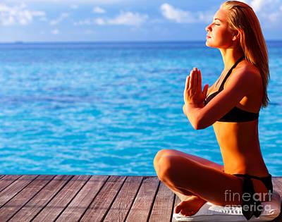 Woman Doing Yoga Photograph - Woman Meditating On The Beach by Anna Om