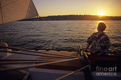 Photograph - Woman On Sailboat Sunset by Jim Corwin
