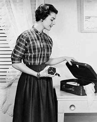 Alarm Clock Photograph - Woman Packing A Suitcase by Underwood Archives