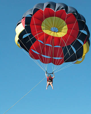 Woman Parasailing Art Print by Rob Huntley