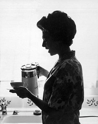 Photograph - Woman Pouring Coffee by Underwood Archives