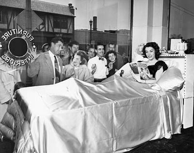 Publicity Photograph - Woman Reading In Bed In Public by Underwood Archives