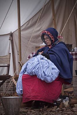 Photograph - Woman Reenactor Sewing In A Civil War Camp by Randall Nyhof