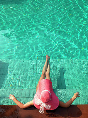 Thailand Photograph - Woman Resting At Edge Of Swimming Pool by Johner Images