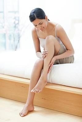Rubbing Photograph - Woman Rubbing Her Leg by Ian Hooton