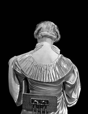 Rubbing Photograph - Woman Rubbing Her Neck by Underwood Archives