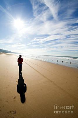 Seagull Photograph - Woman Silhouette Walking Alone At The Beach by Jose Elias - Sofia Pereira