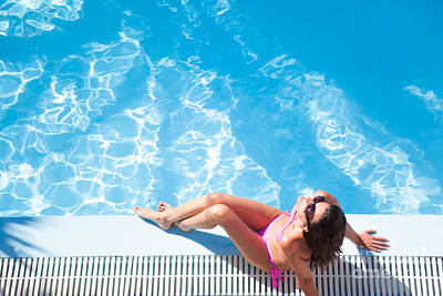 Suntanned Photograph - Woman Sunbathing By The Swimming Pool by Matteo Colombo