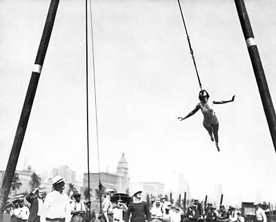 1918 Photograph - Woman Swings With Her Teeth by Underwood Archives