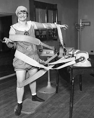 Exercise Photograph - Woman Tangled In Shimmy Straps by Underwood Archives