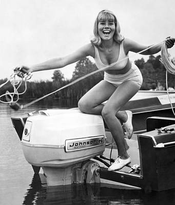 Skiing Photograph - Woman Throwing A Boat Line by Underwood Archives