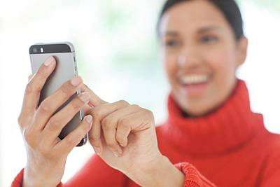 Focus On Background Photograph - Woman Using Smartphone by Ian Hooton