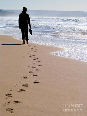 Footprints Photograph - Woman Walking Alone At The Beach by Jose Elias - Sofia Pereira