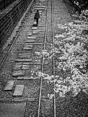 Cherry Blossoms Road Photograph - Woman Walking Along Rail Road Track by John Wong