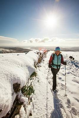 Scree Photograph - Woman Walking In Deep Snow by Ashley Cooper