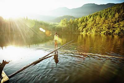 Photograph - Woman Walking On Log In Alpine  Lake by Thomas Barwick