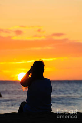 Photograph - Woman Watching The Sunset On A Beach In Maui Hawaii Usa by Don Landwehrle