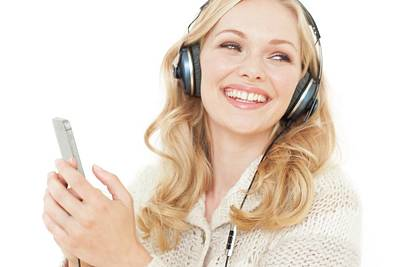 Wavy Hair Photograph - Woman Wearing Headphones With Smartphone by Ian Hooton
