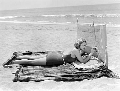 Sunbathers Photograph - Woman With A Beach Screen by Underwood Archives