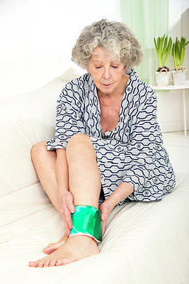 Woman With A Cold Compress On Ankle Art Print by Lea Paterson