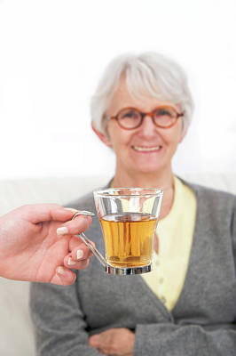 Two People Holding Hands Photograph - Woman With A Hand Holding Glass Of Tea by Lea Paterson