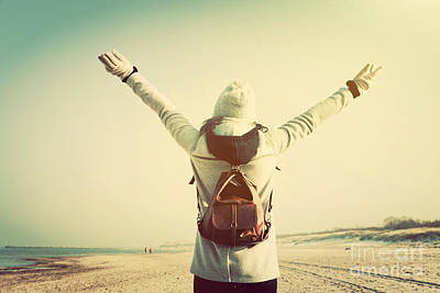 Journey Photograph - Woman With Hands Up Wearing Retro Backpack On The Beach by Michal Bednarek
