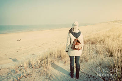 Woman With Retro Backpack On The Beach Looking At The Sea Art Print
