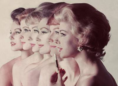 In A Row Photograph - Women Wearing Revlon Lipstick by John Rawlings